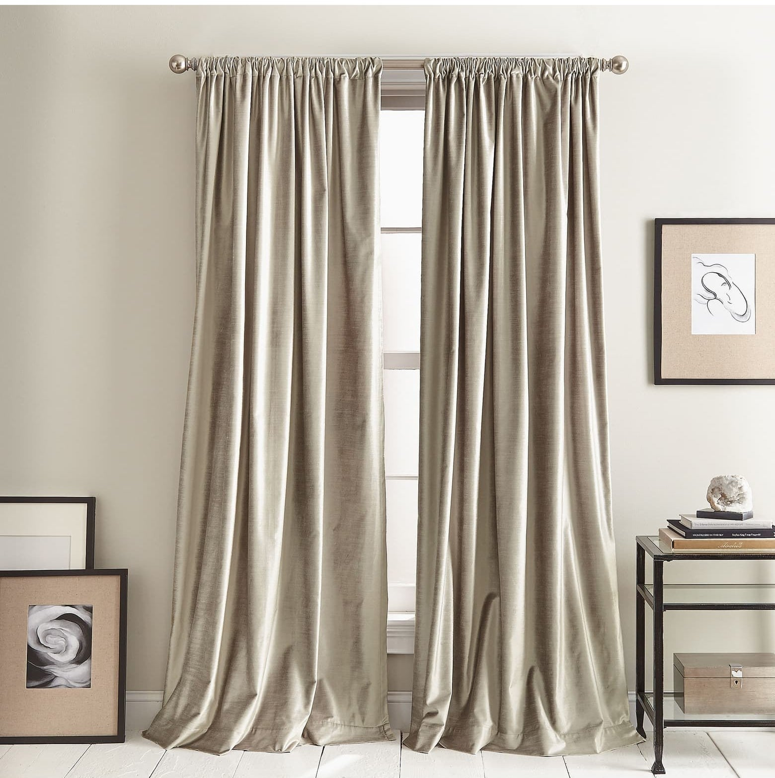 The velvet curtains in gold on a window in a room