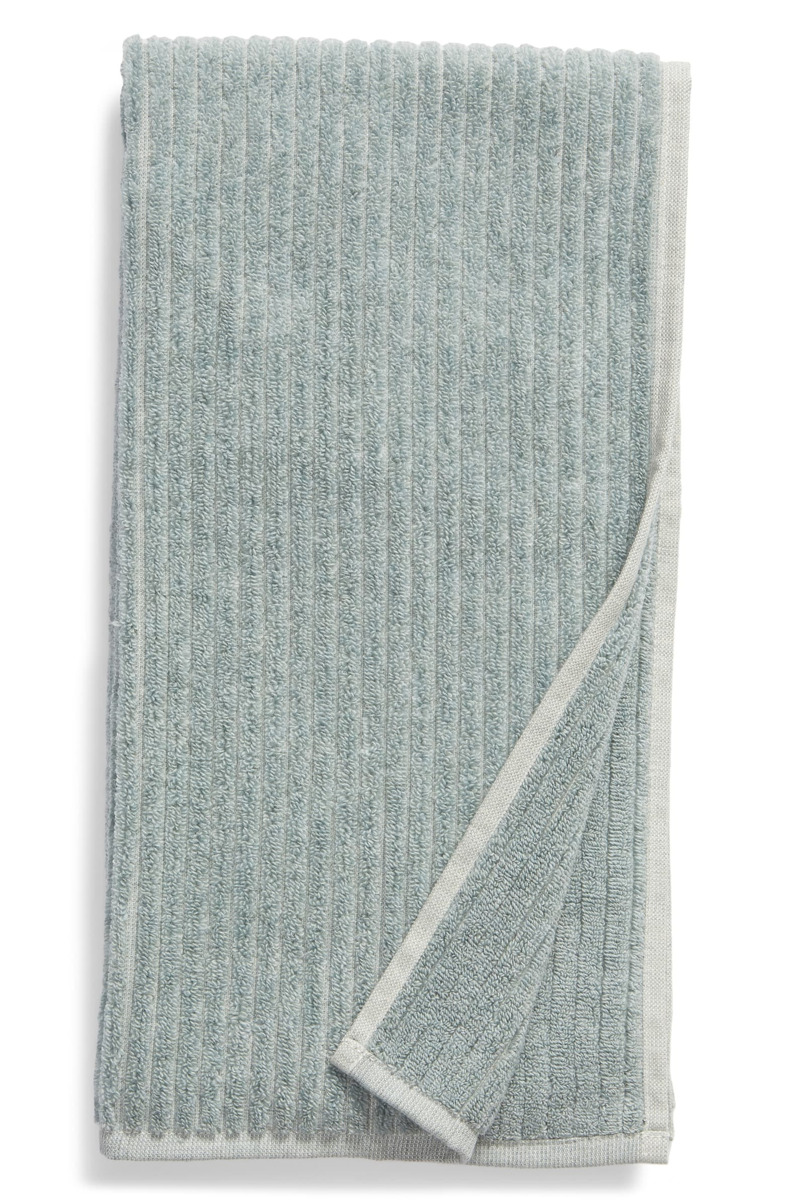 The ribbed hand towel with vertical lines in teal