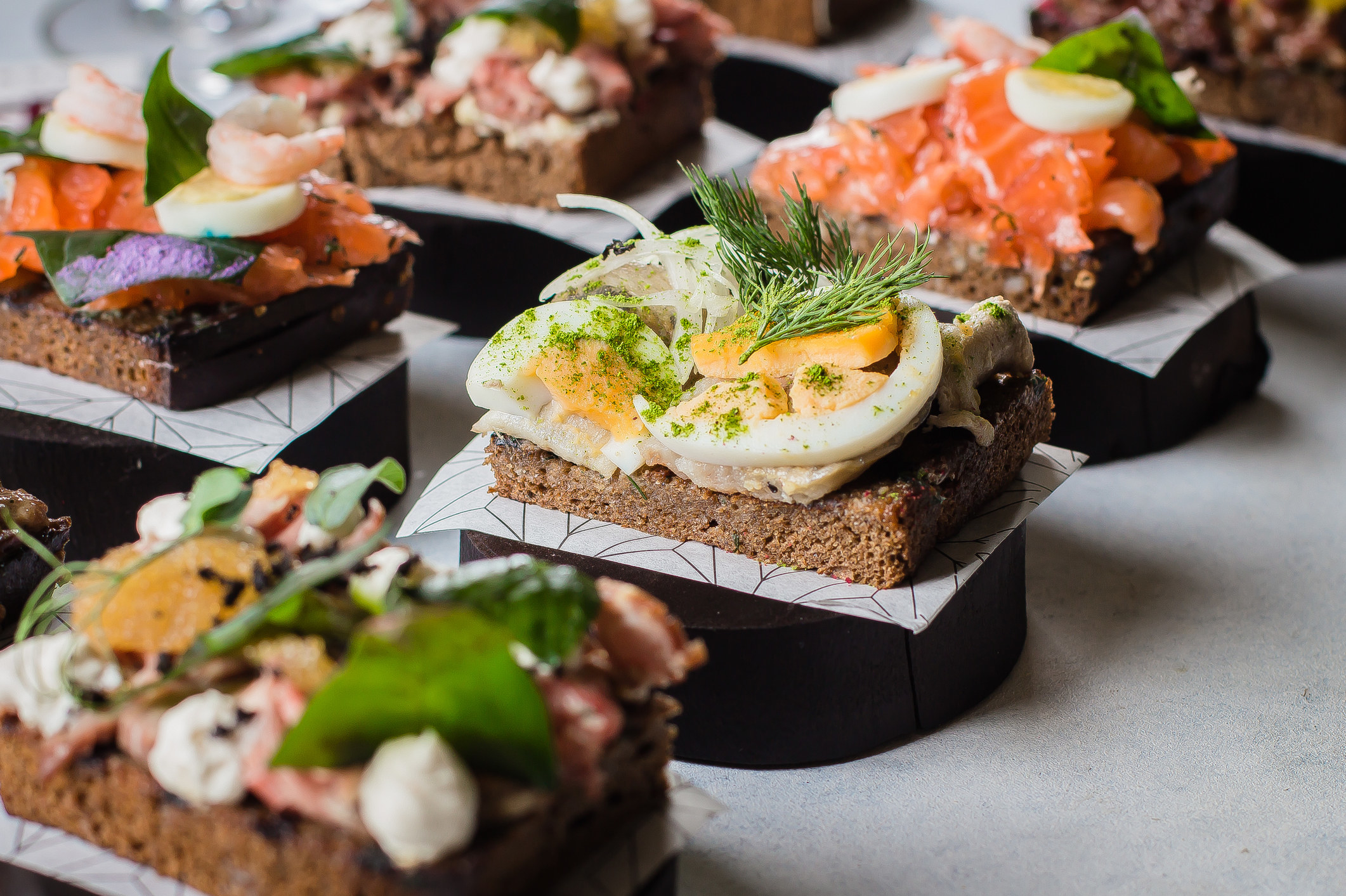 Traditional Danish open sandwiches, dark rye bread with different fresh toppings