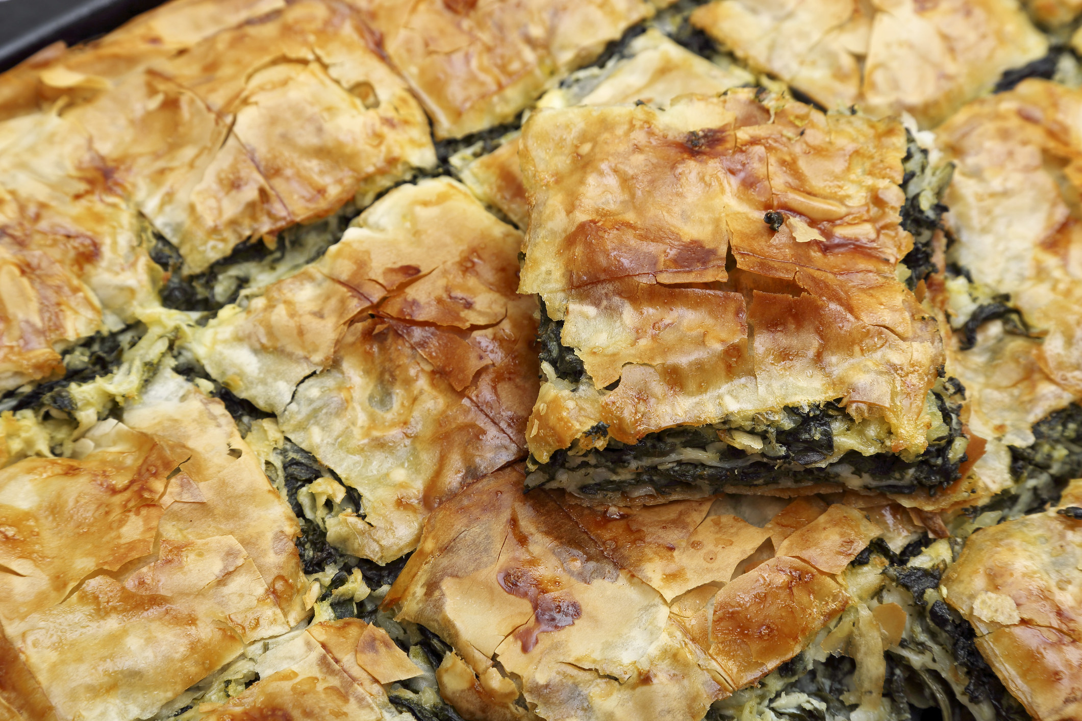 flaky, golden brown pastry filled spinach and cheese