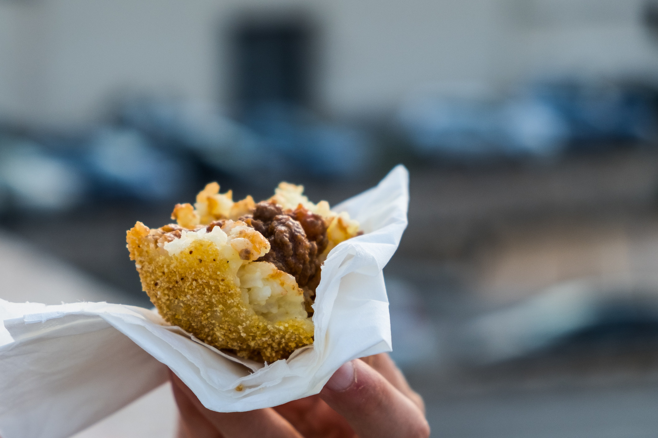 crispy, golden fried ball of rice with a meat filling
