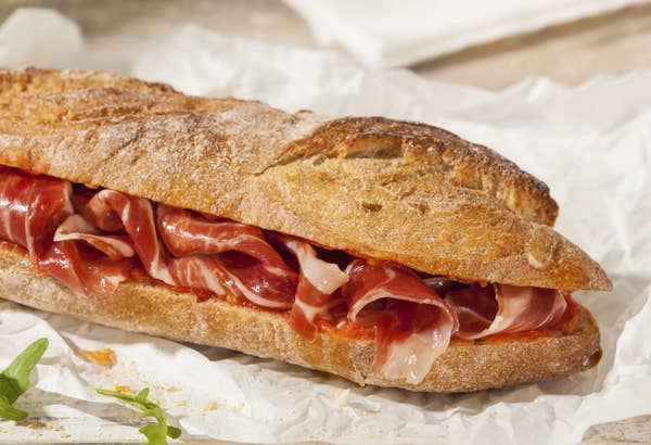 crusty baguette filled with generous amounts of thinly sliced jamon (ham)