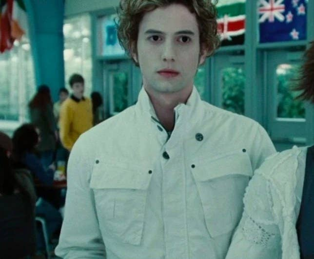 Jasper in the school cafeteria in Twilight, looking pained