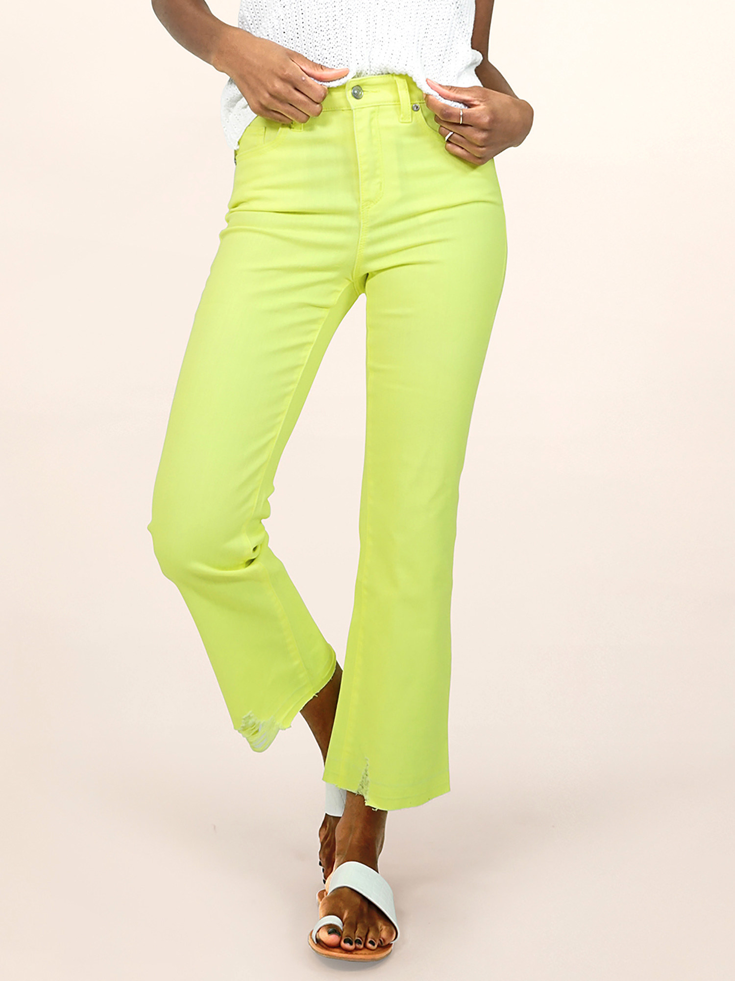 Model in neon yellow flare jeans