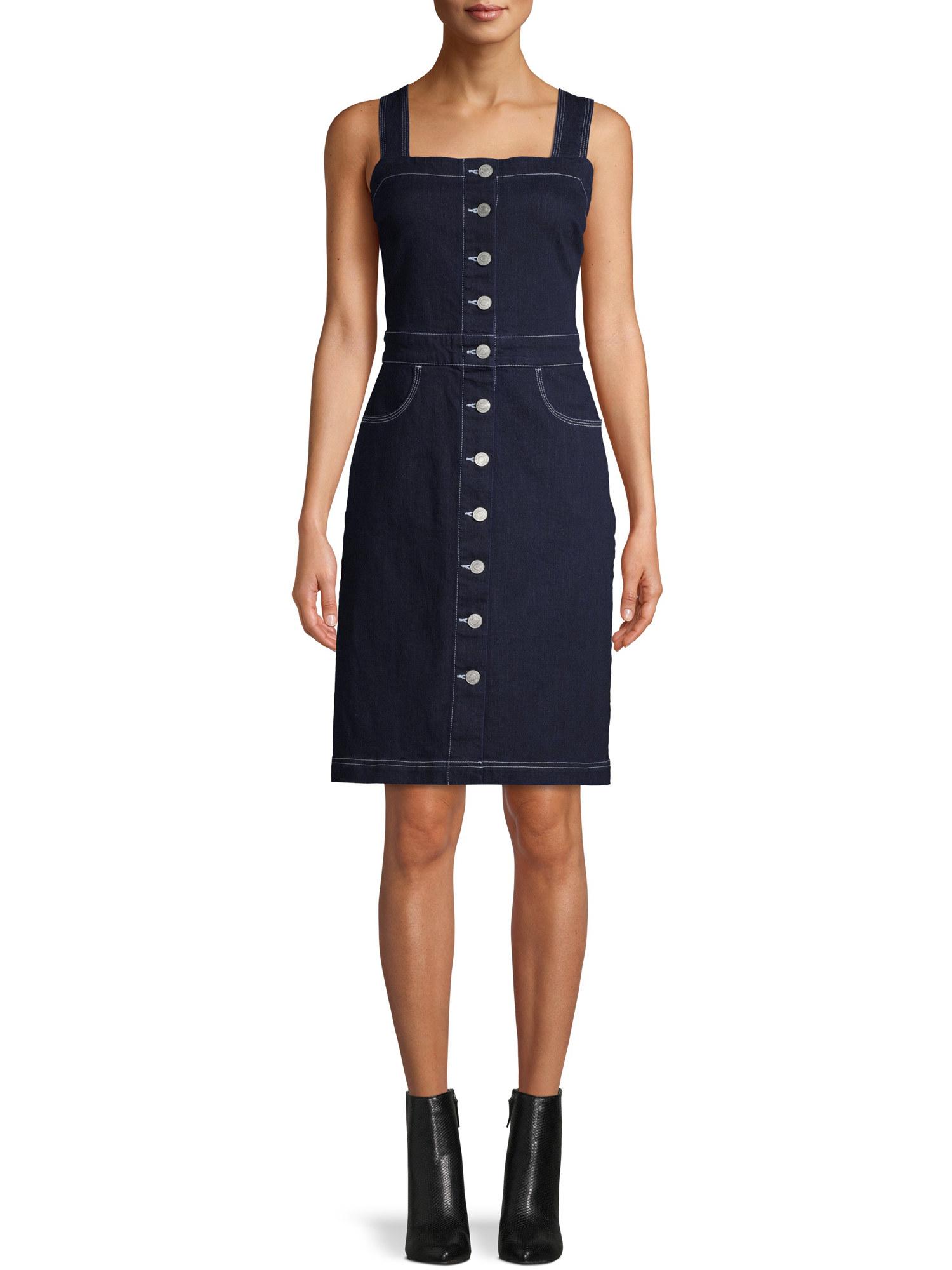 Model in button up sleeveless denim dress