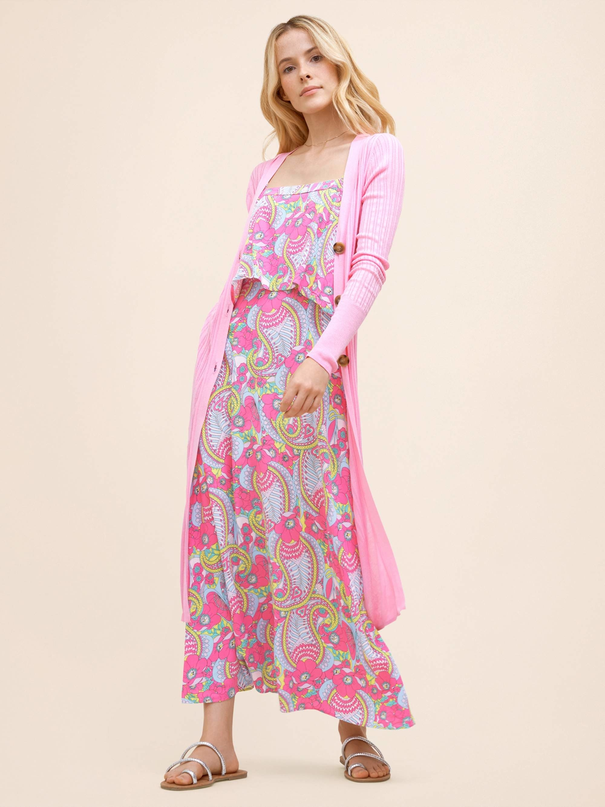 Model in pink paisley dress