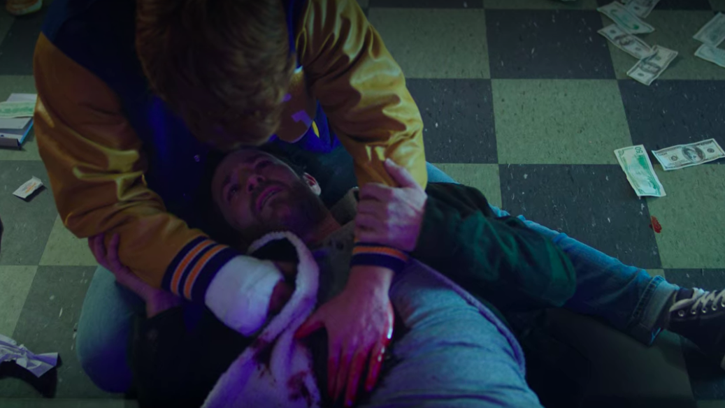 Archie holding his dad after Fred is shot
