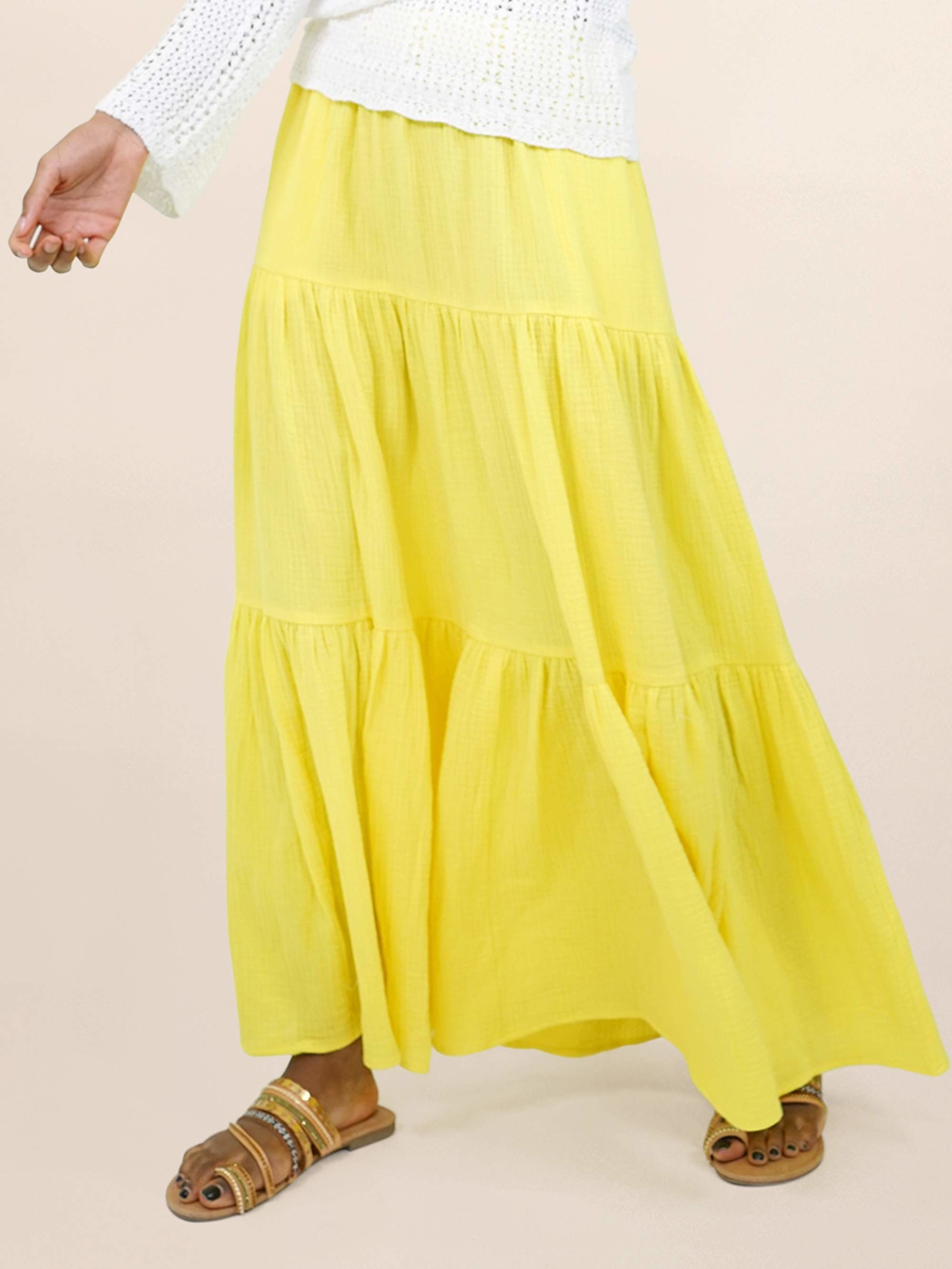 Model in tiered yellow maxi skirt