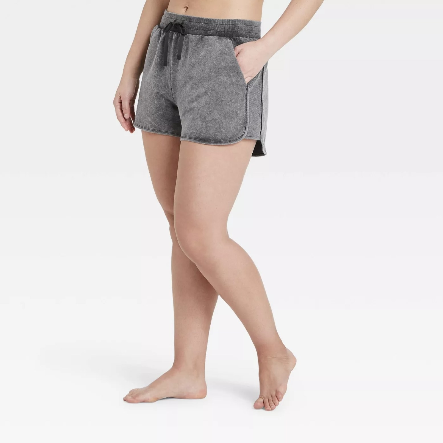 Model is wearing grey shorts with a drawstring waist band