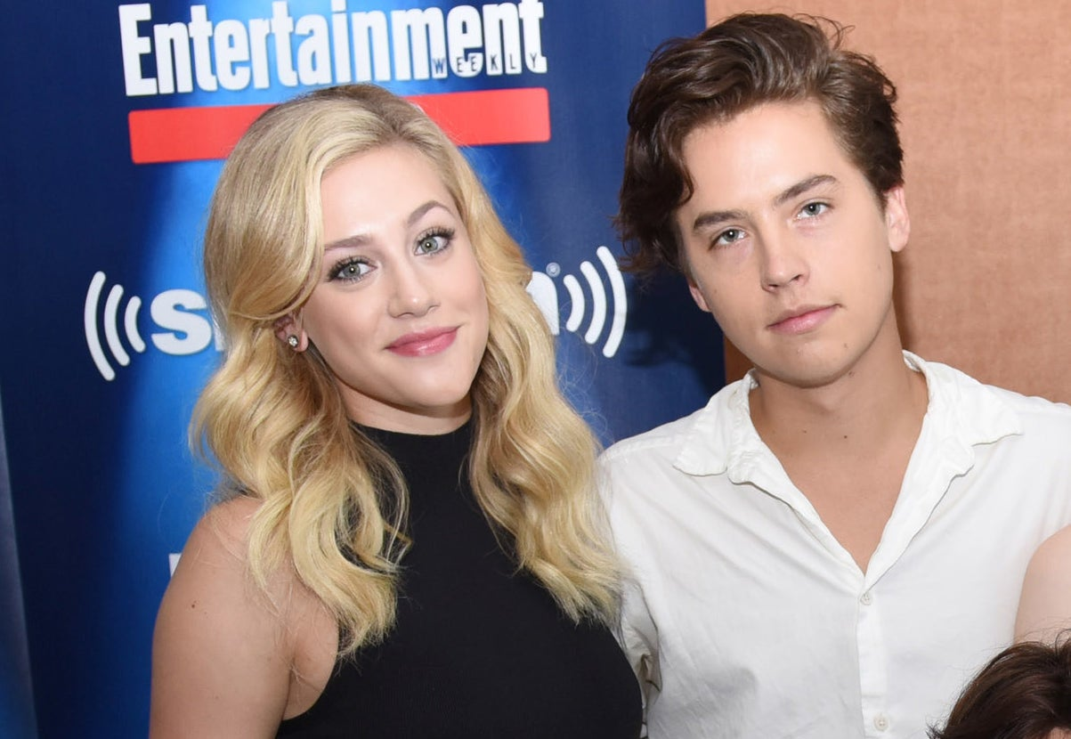 Lili Reinhart and Cole Sprouse pose together during a live cast interview