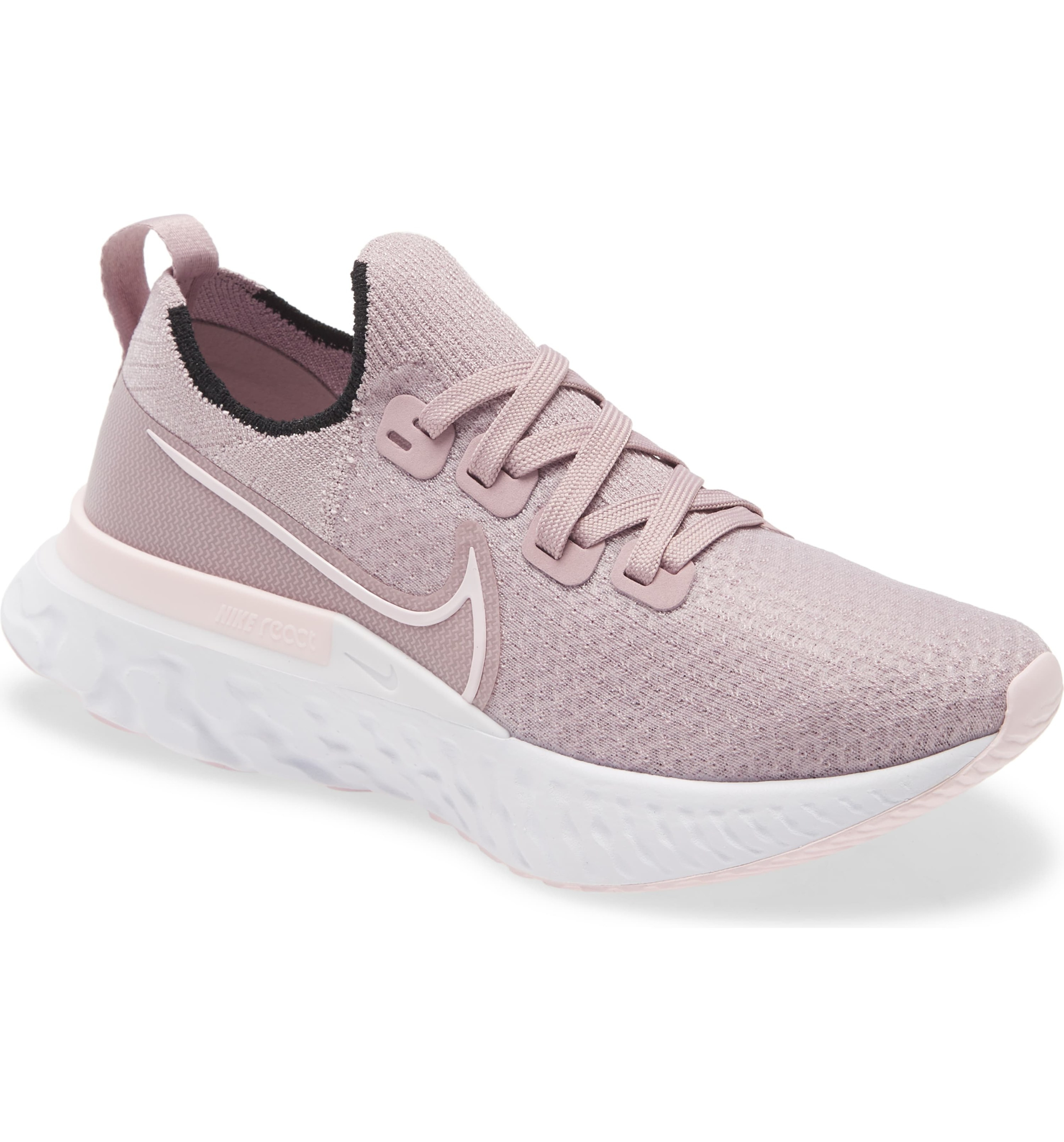 light pink knit nike running shoes