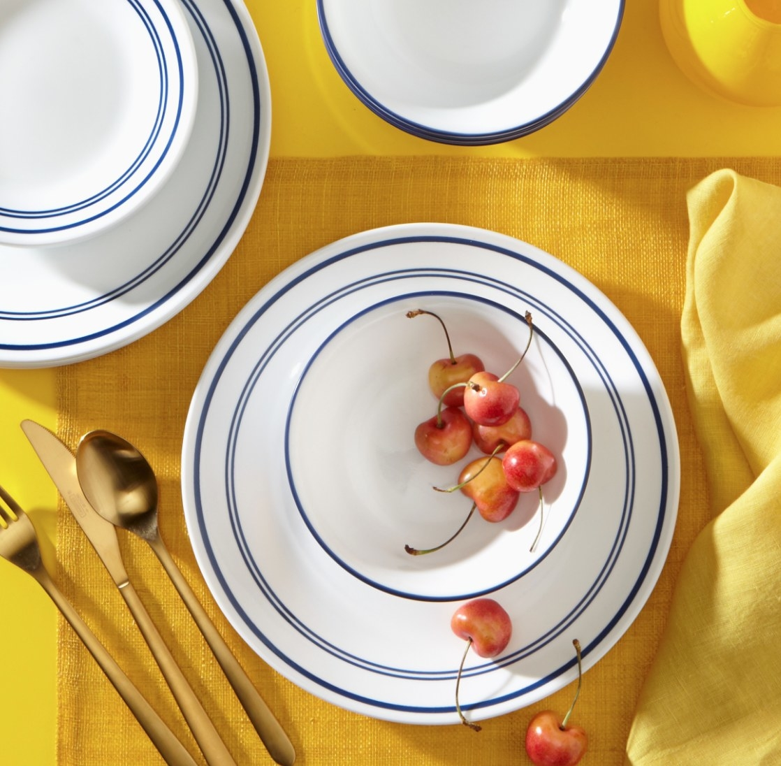 Blue and White Tableware on a yellow tablecloth