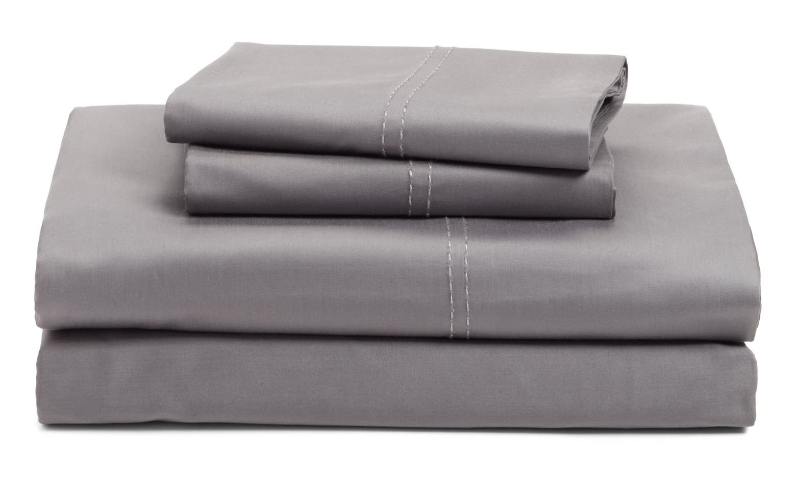 The sheets in grey folded with pillowcases folded on top