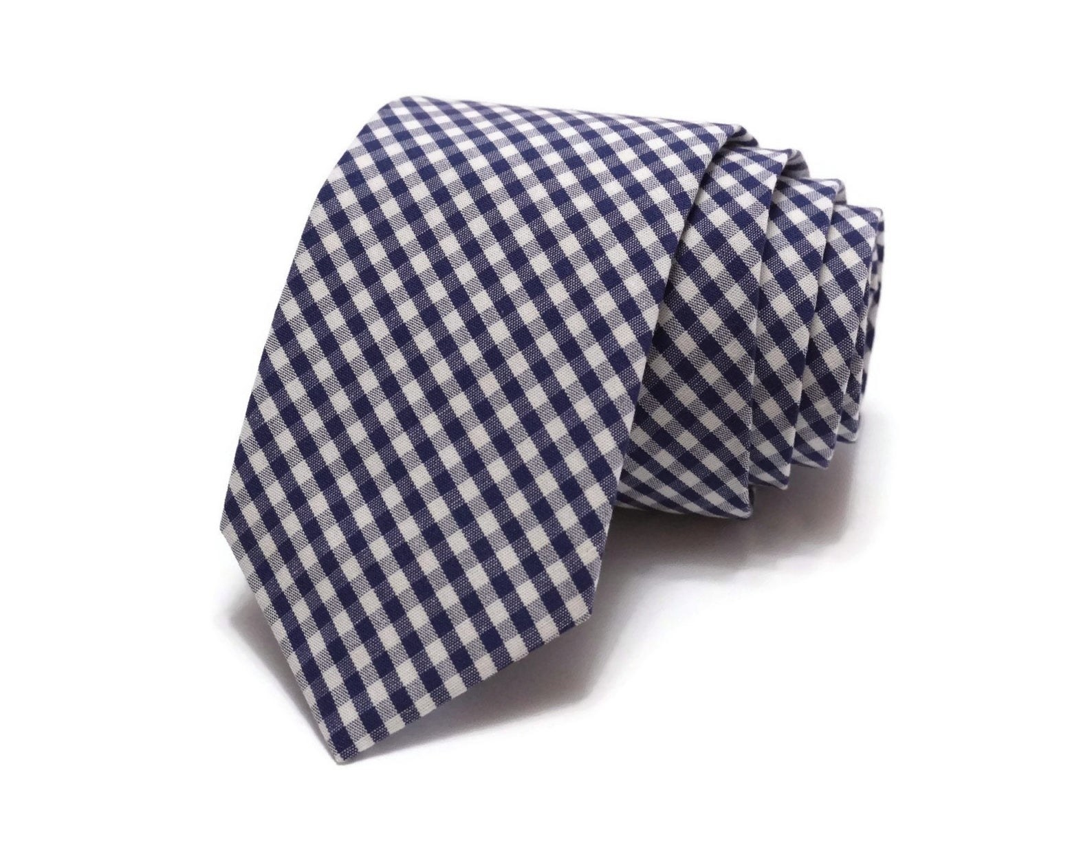 A navy blue gingham check tie rolled up