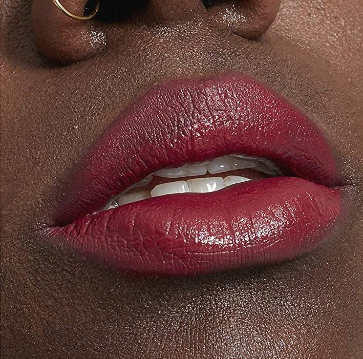 A close up of someone's parted lips wearing the diffused lip colour
