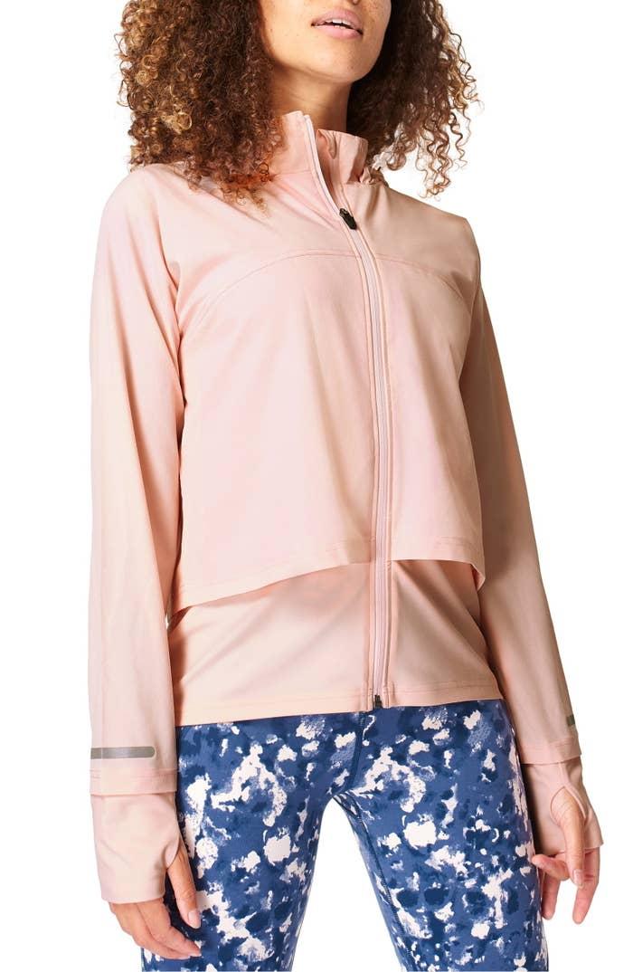 Model wearing Sweaty Betty Fast Track Jacket in liiberated pink