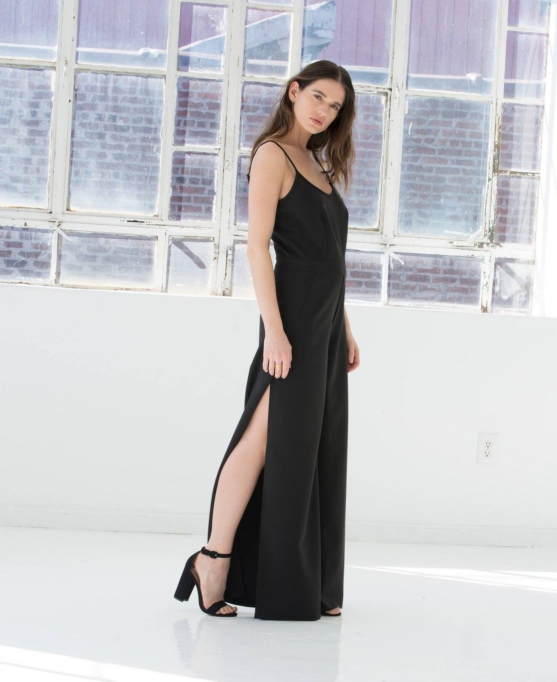 A model wearing the black spaghetti strap jumpsuit