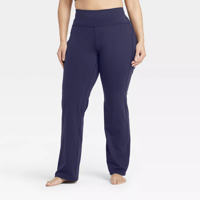Model is wearing navy straight-leg pants