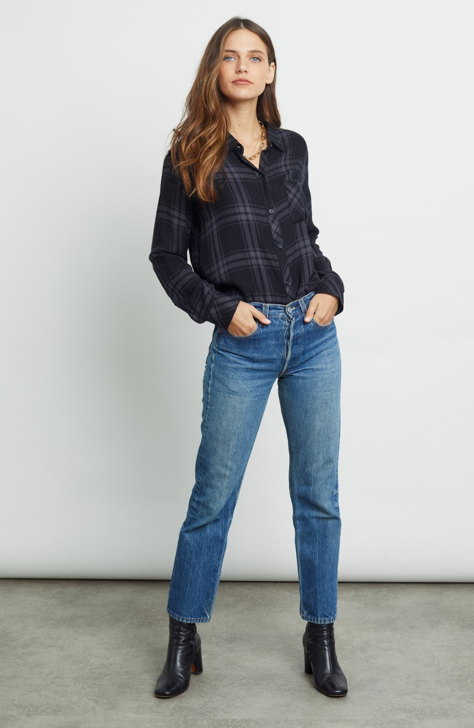 a model in a smoky blue flannel