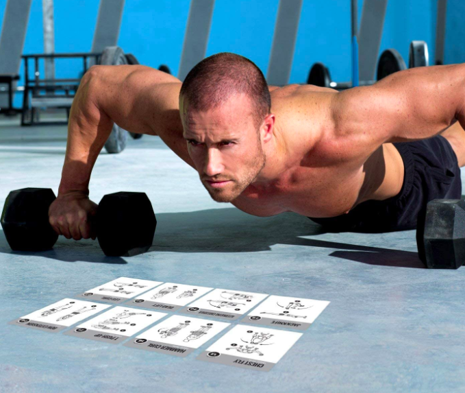 Model goes down in push-up position behind a stack of exercise cards with different movements