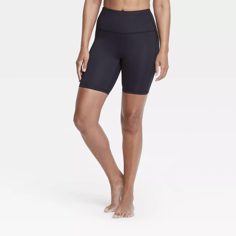 Model is wearing black high rise bike shorts