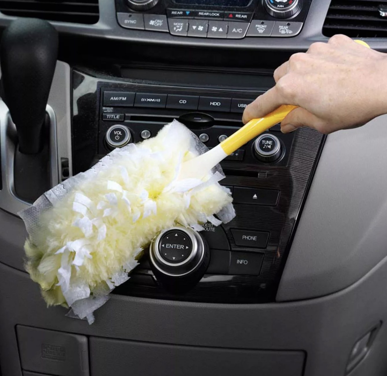 The duster being used on a car console