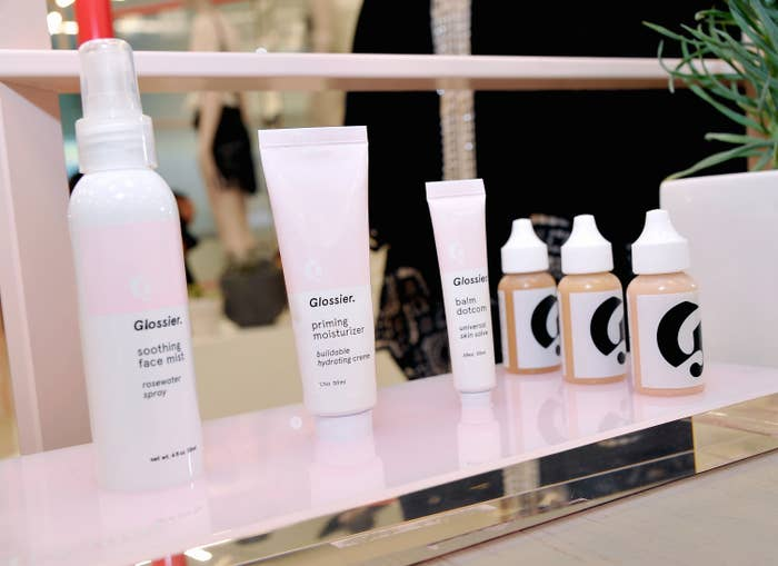 Various beauty products sit on a shelf