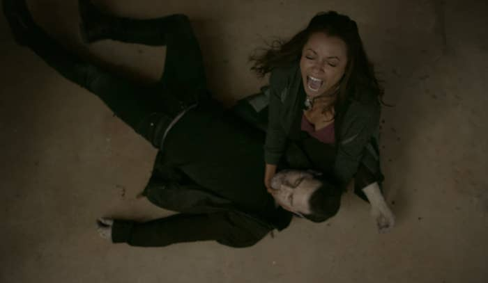 Bonnie screaming and crying while holding Enzo's body