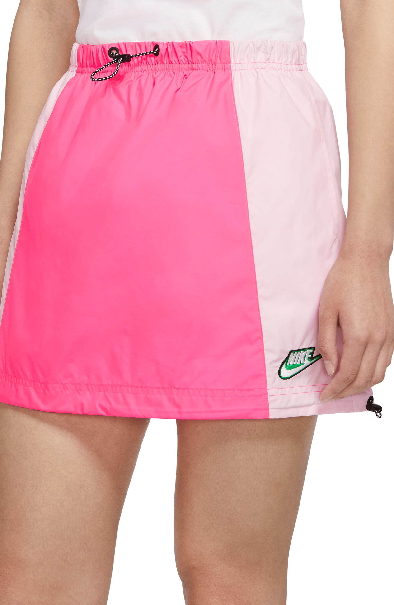 Model wearing Sportswear Icon Clash Colorblock drawstring skirt by Nike in hyper pink colorway