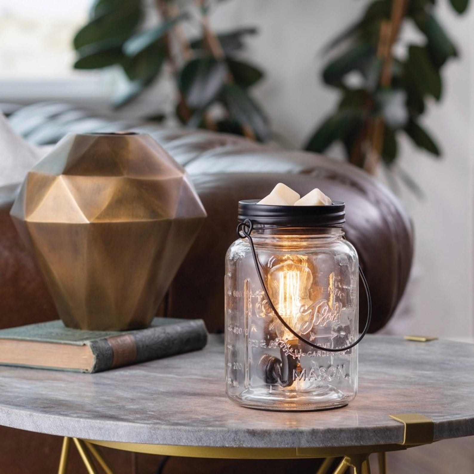 Clear Mason Jar with an Edison light bulb inside and wax melts on top of the lid