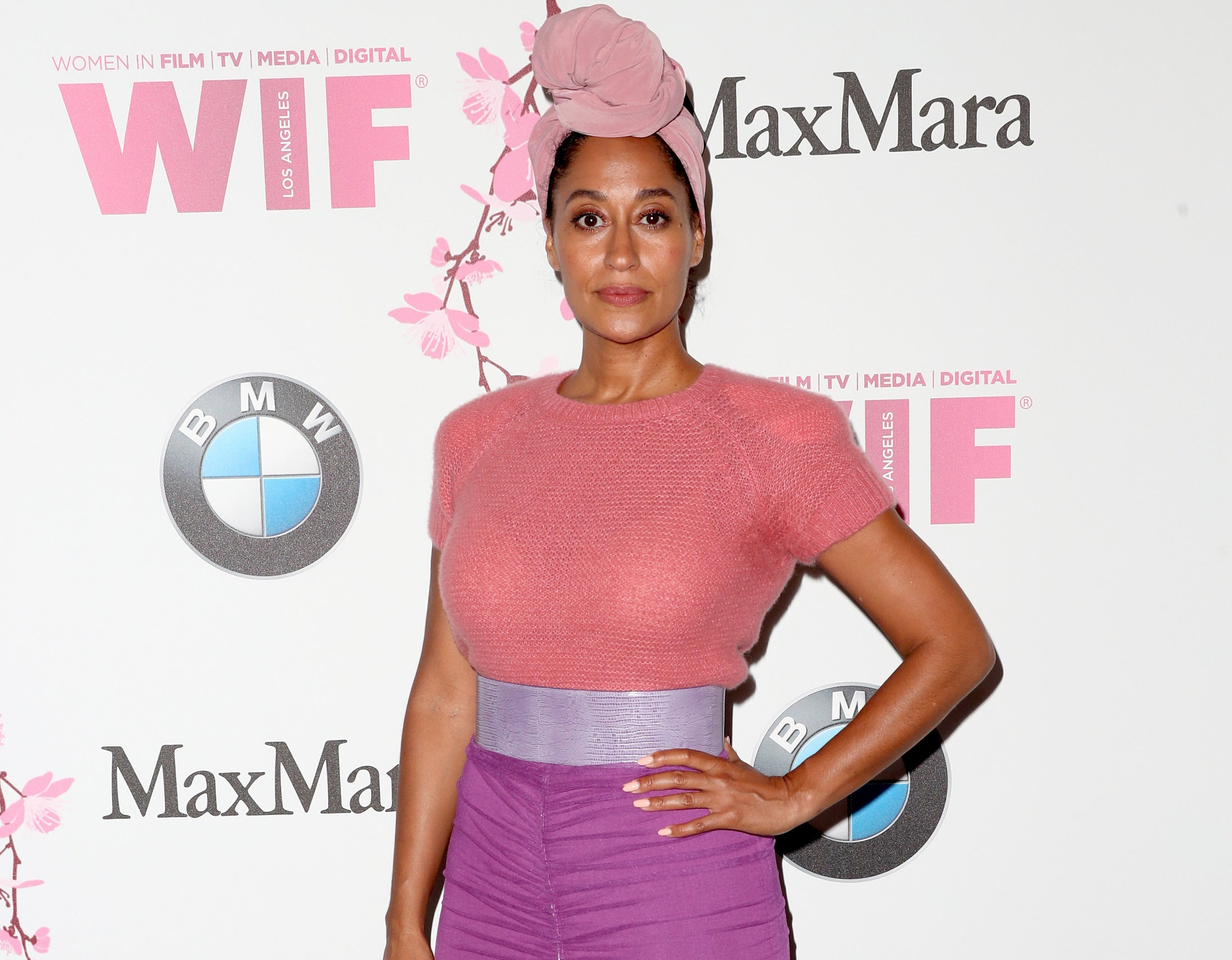 Tracee Ellis Ross wearing a bright top and skirt, posing at a Hollywood event