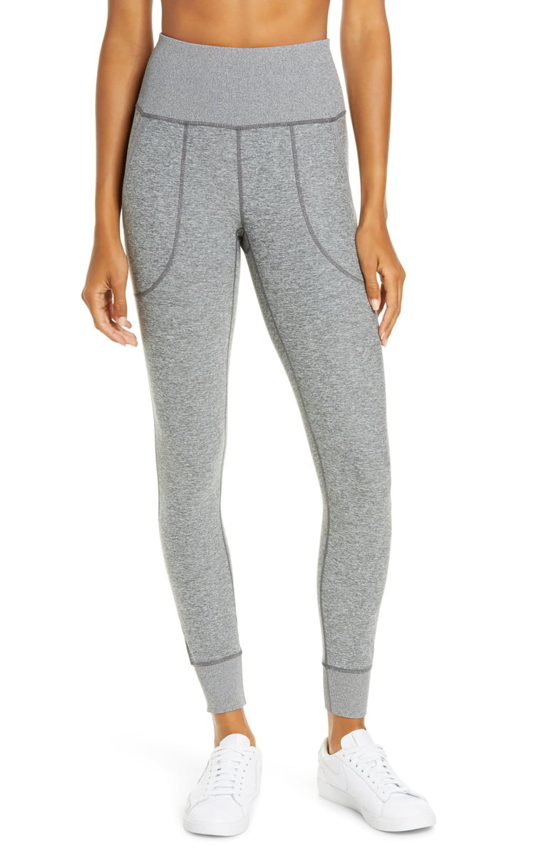 Model wearing Zella Restore Pocket Lounge leggings in grey shade