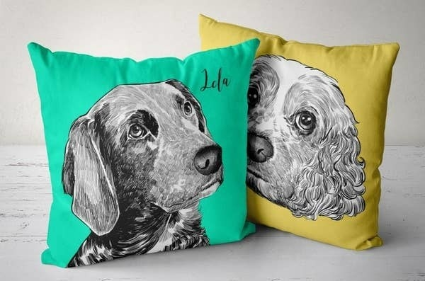 A green and yellow pillow, each with illustrated photos of dogs on them