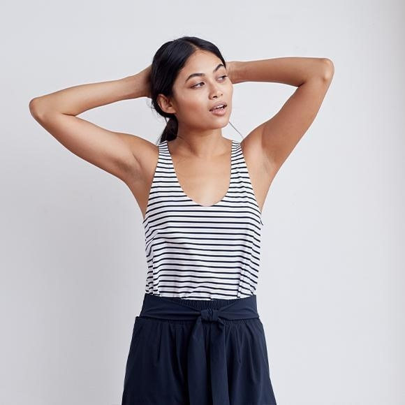 Model wearing the scoop-neck tank with navy blue stripes