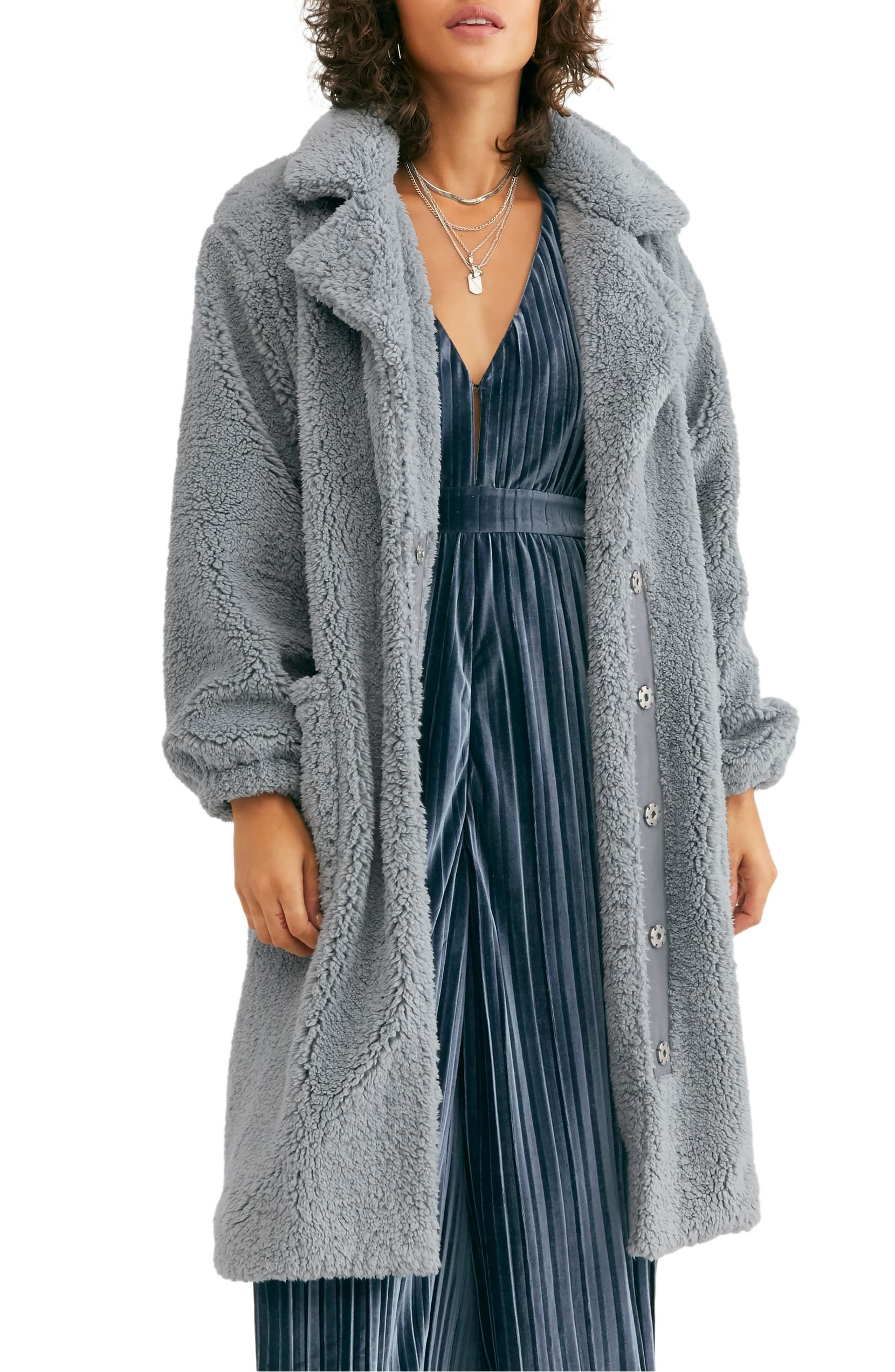 Model wearing the longline coat, featuring high-pile fleece and pockets