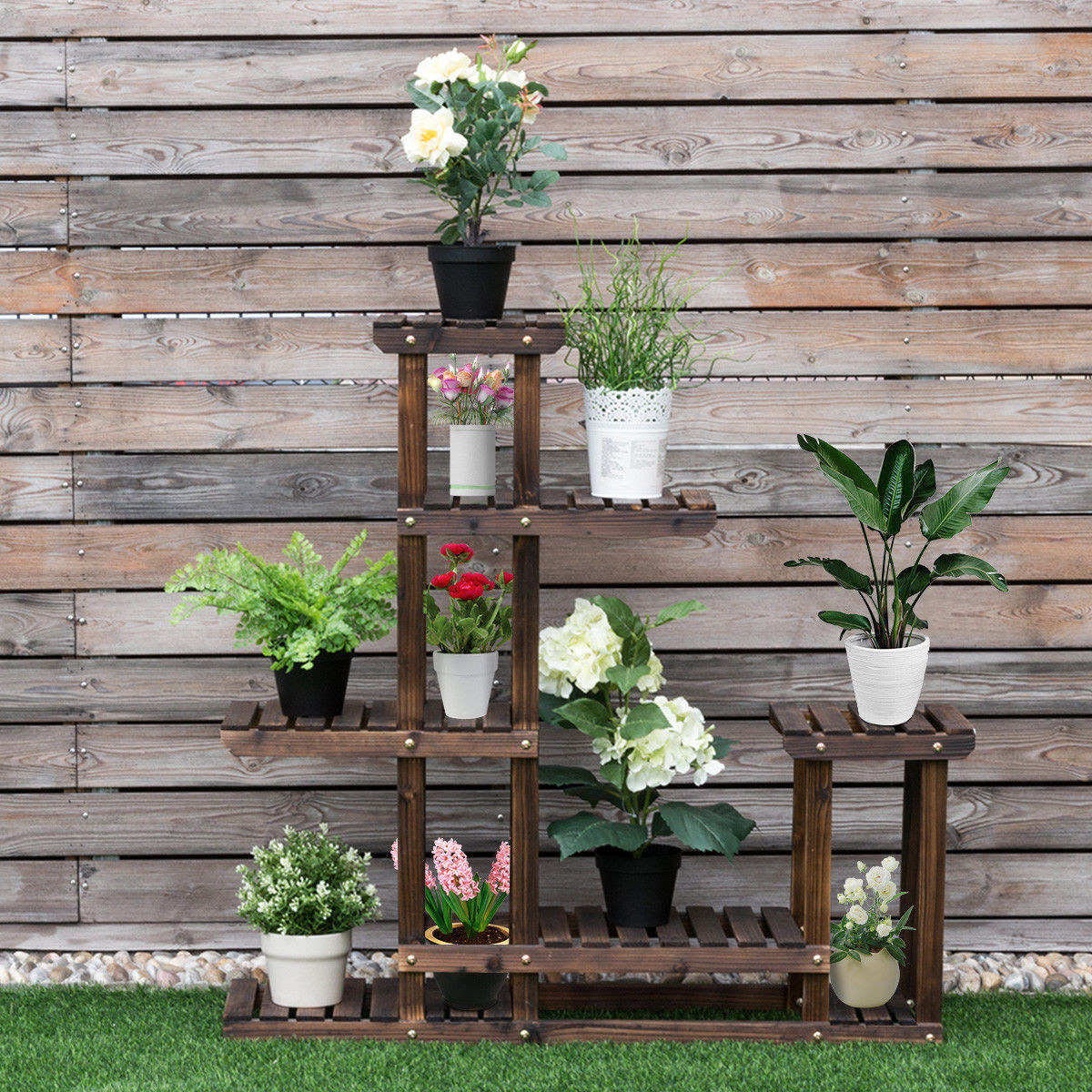 The Costway Outdoor Wooden Flower Plant Stand with flower pots on every of its six shelves