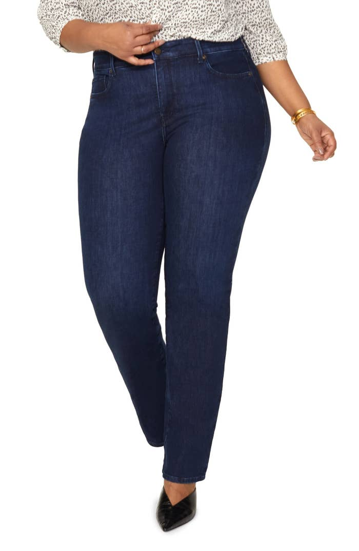Model wearing the jeans in a dark wash