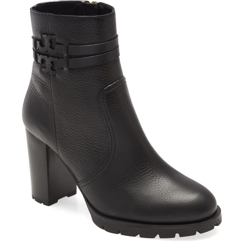 The heeled black booties with the iconic T-logo wrapped around the ankle