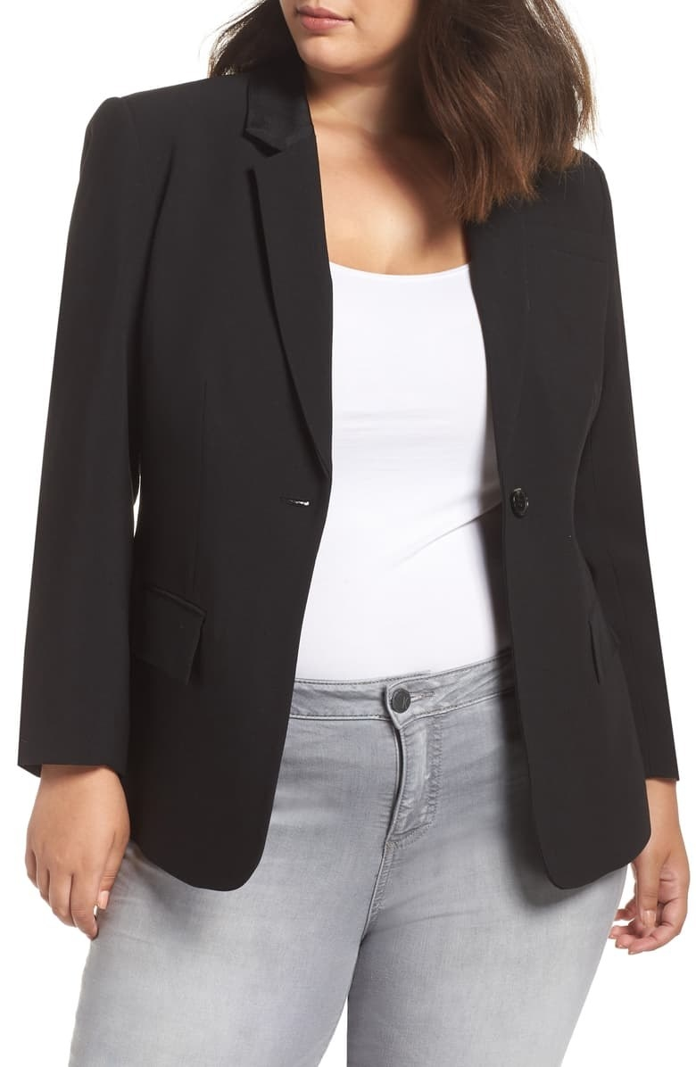 Model wearing the black single-button blazer