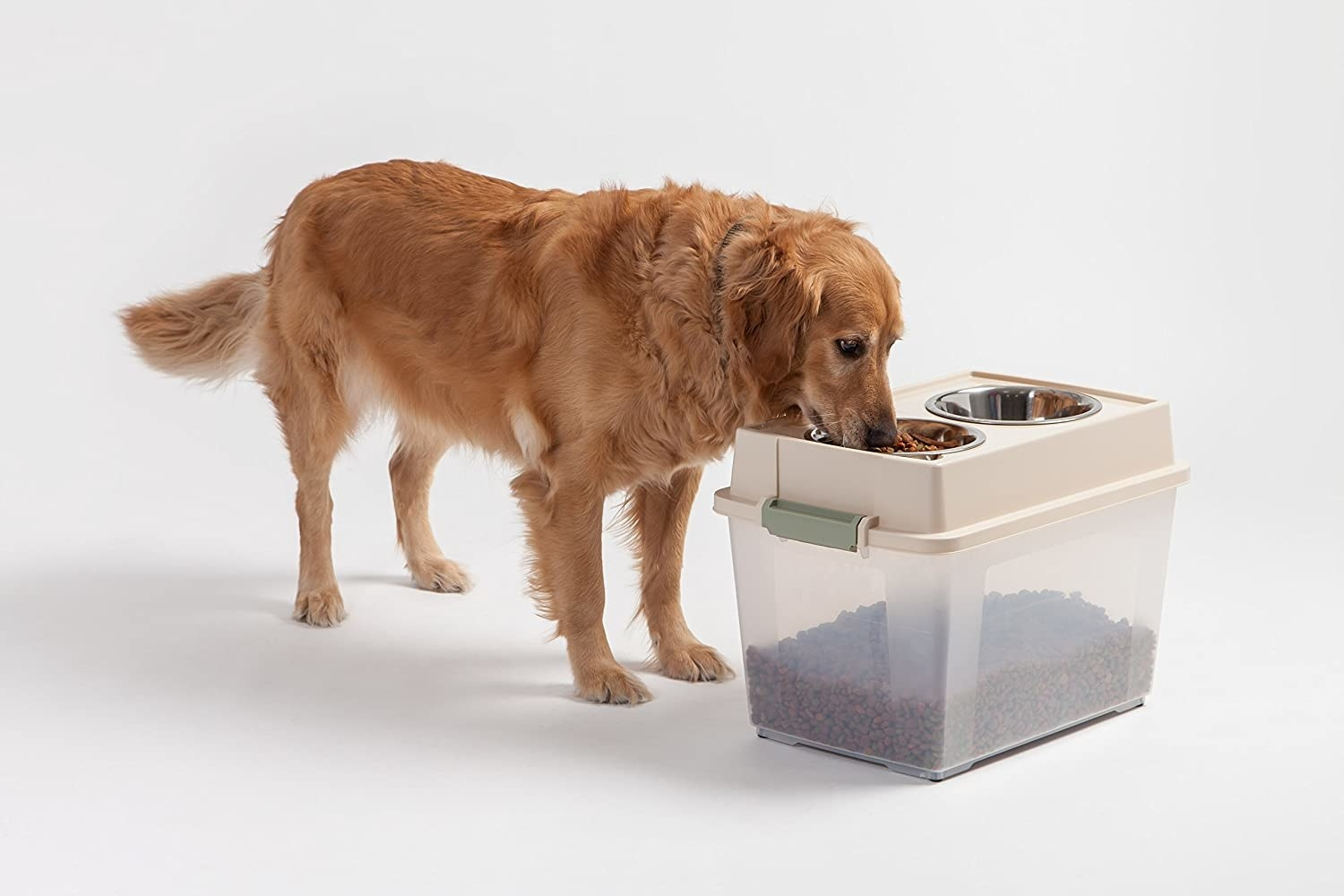Dog eating out of the two-bowl lid with the large storage bin of dry food attached as the bottom