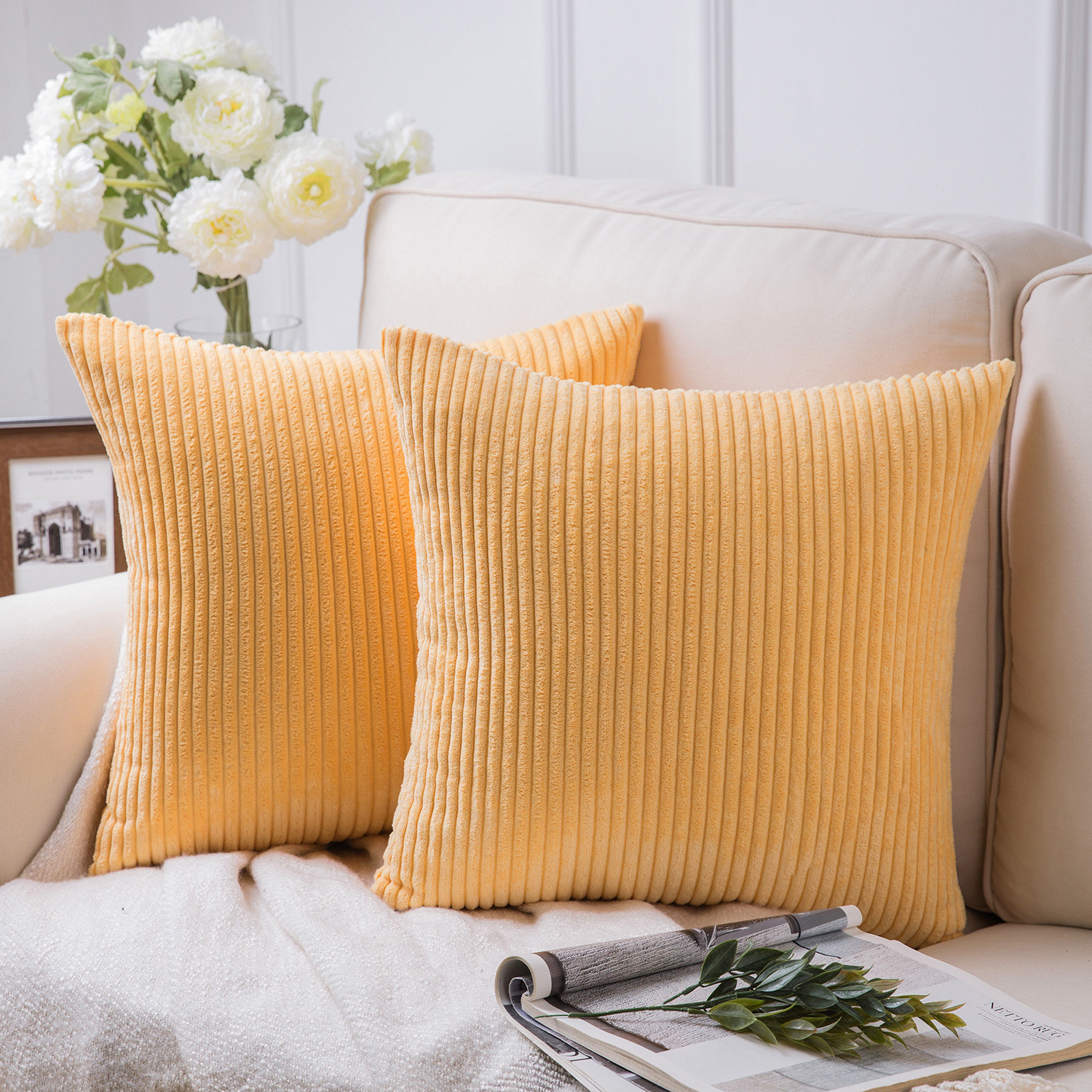 Two beige-colored pillows with corduroy ribbing