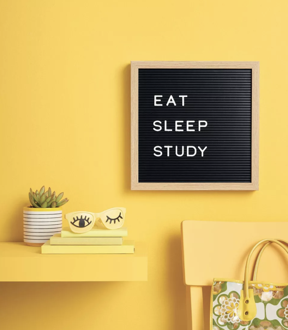 "the letterboard on a yellow wall with the words ""eat sleep study"" on it"