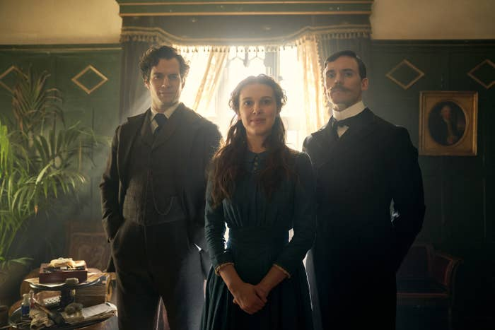 The Holmes family stands side by side as if they're taking a family portrait