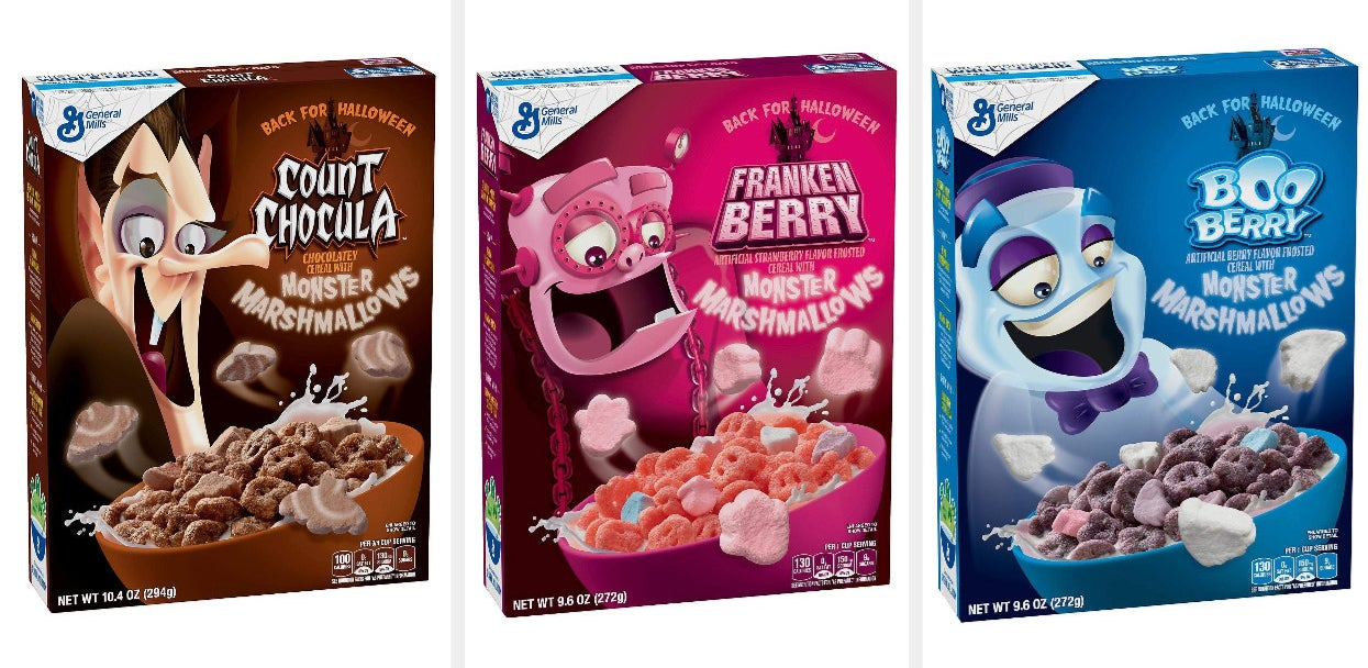 A brown box of Count Chocula, a pink box of Franken Berry, and a blue box of Boo Berry