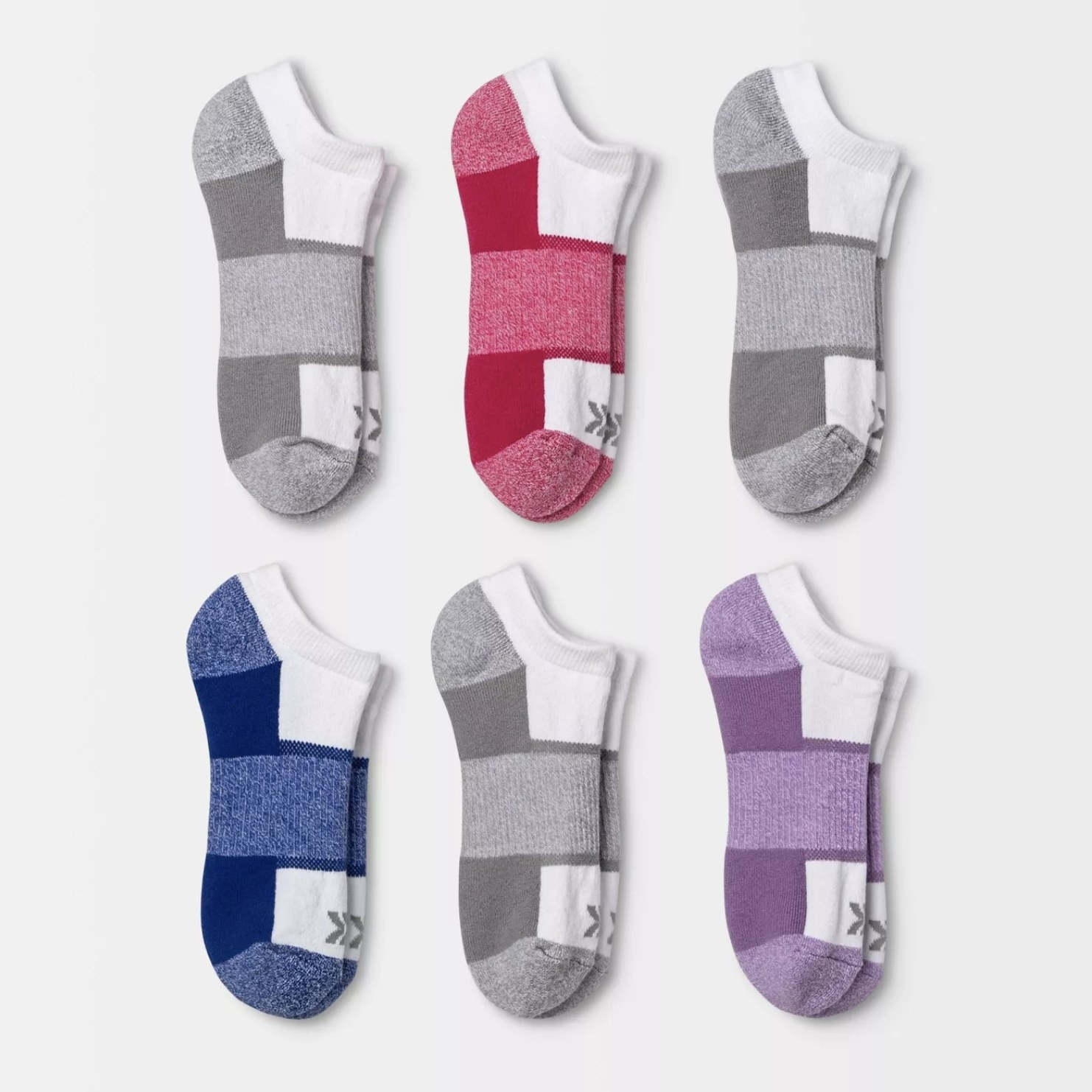 Six pairs of white socks with grey, purple, and red colors