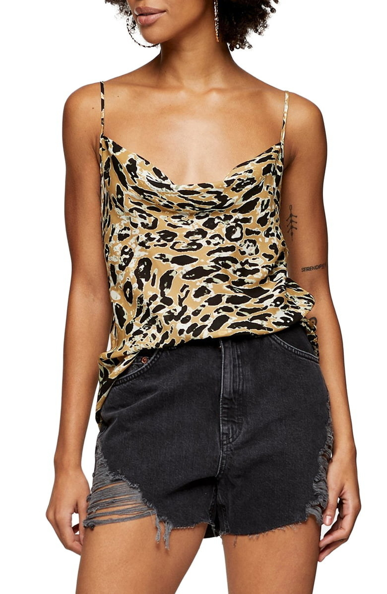 A closeup of the Topshop Cowl Neck Satin Camisole on a model