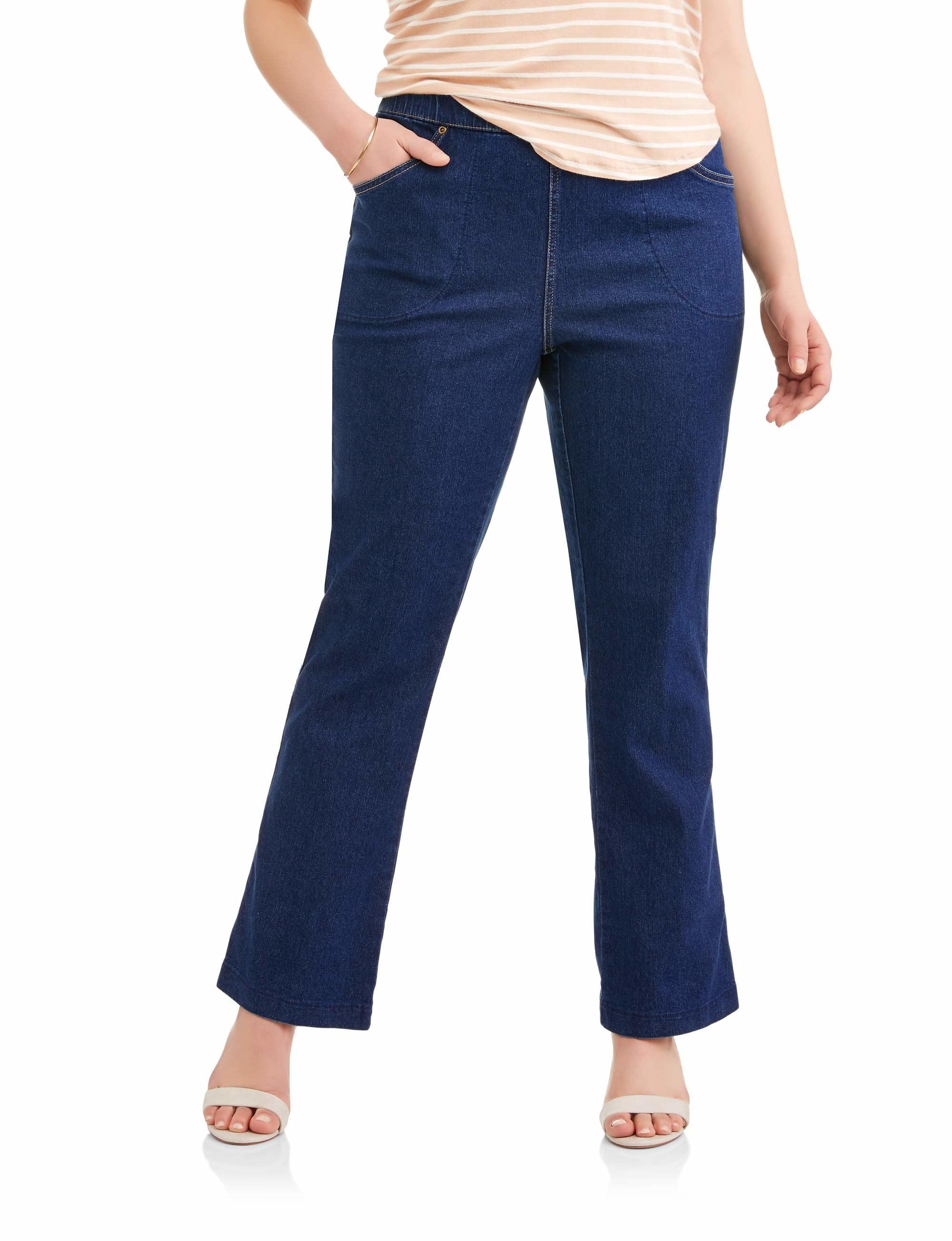 model in dark blue bootcut denim jeans
