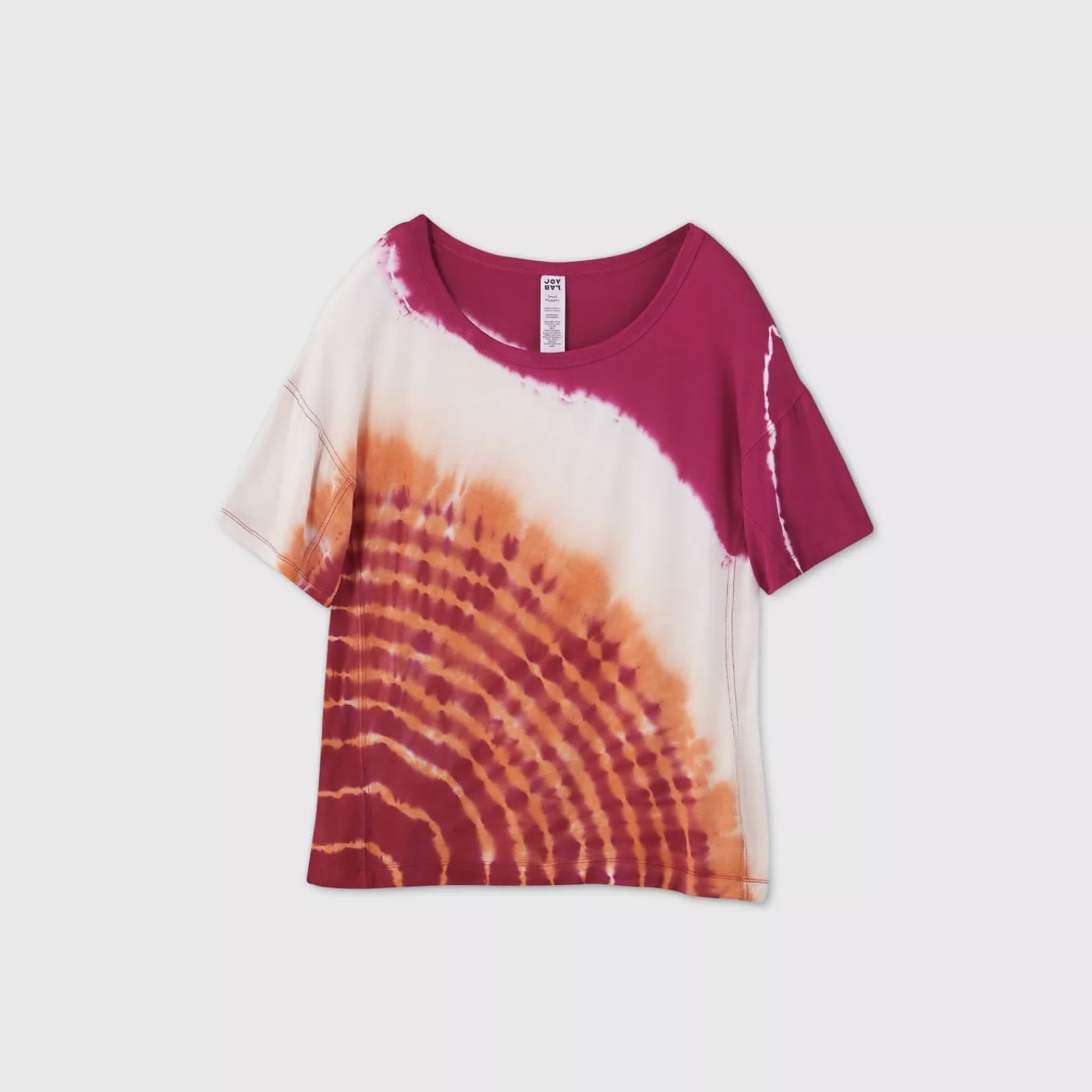 A pink, white, and orange tie-dye short sleeve top with a scooped neckline