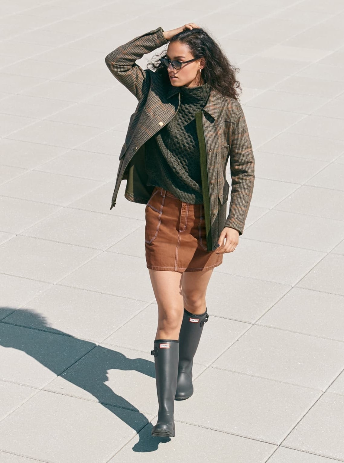 Model wearing the knee-high boots