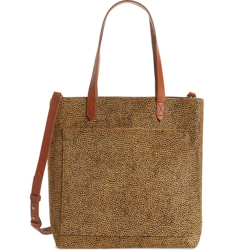The tote, featuring gold hardware and brown straps